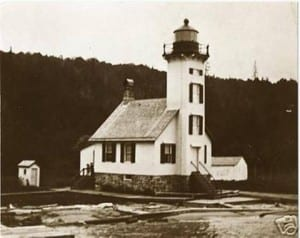 Resembling a small country church in style, its original color was white. The location, opposite the dangerous shoal at Sand Point, was critical for safe navigation.